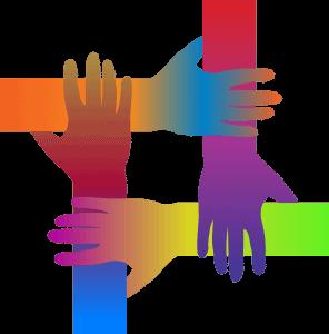 les mains et les bras aux couleurs de l'arc-en-ciel s'interconnectent